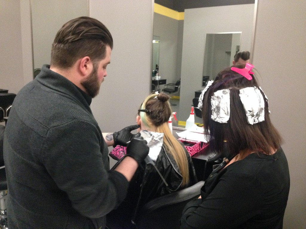 Davines Educator Josh Howard demonstrating on Amber's Beauty School Students