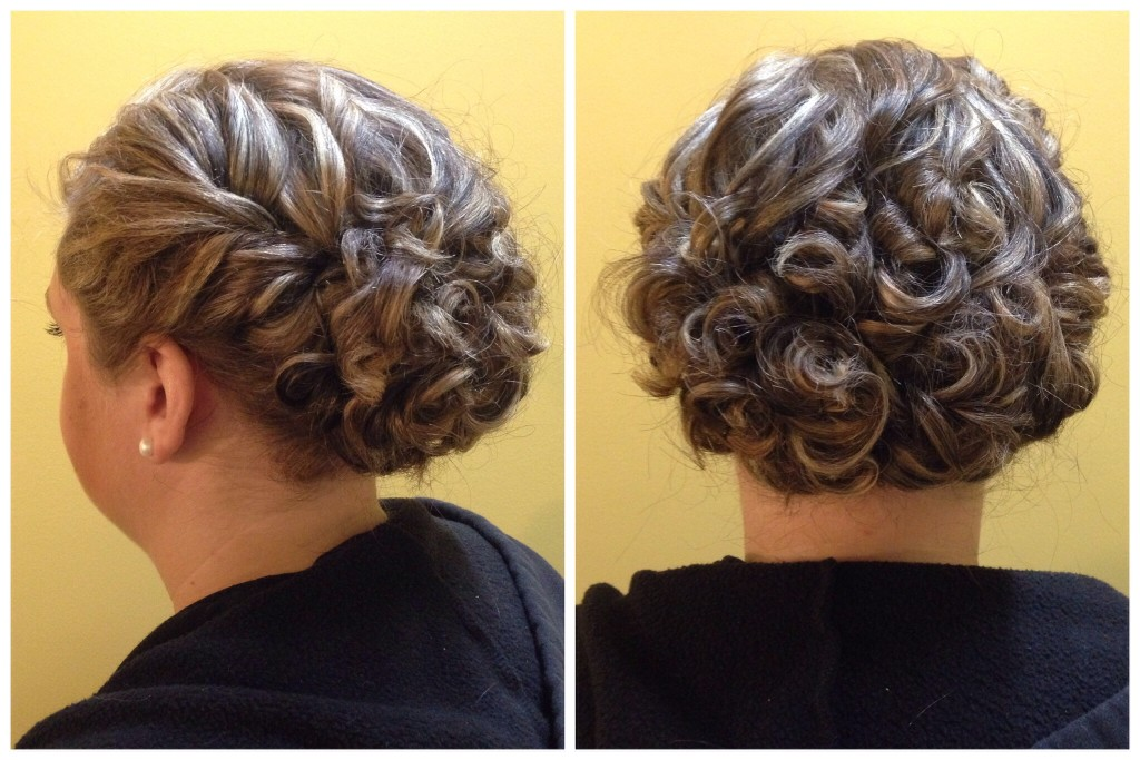 Curled and twisted updo by Amber's Beauty School students